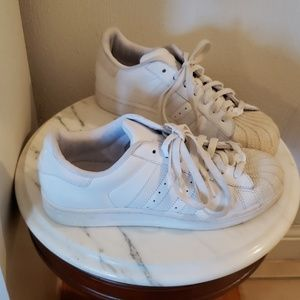 All white Adidas shell toe